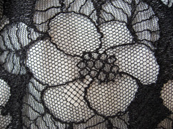 detail of a lace camelia, Chanel 05a skirt
