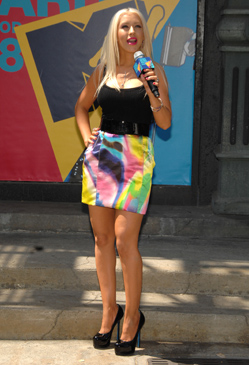 Christina Aguilera promoting the VMAs in a Dolce & Gabbana skirt