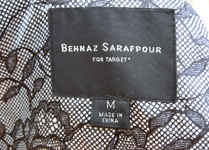 Behnaz' trench is fashionably lined in lace