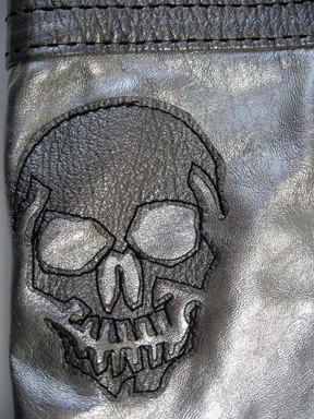 detail of a skull on the reverse of the Great China Wall bag