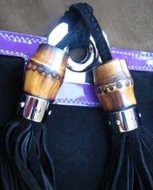 Bamboo tassels on the Gucci Indy bag