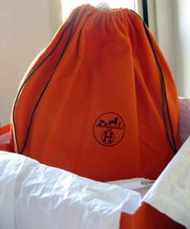 Hermes orange dust bag has been replaced