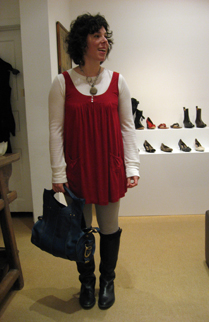 Raquel models a LeFlesh handbag at Hu's