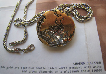 Reverse of Sharon Khazzam World Pendant with rubies in Florida and Japan