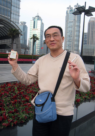 Liu Wei with his brand of cigarettes