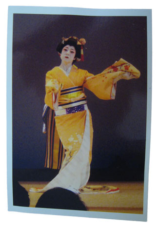 Motoko on stage in traditional costume