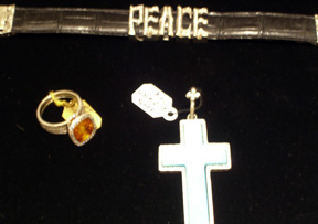 Loree Rodkin ring, belt buckle and turquoise cross
