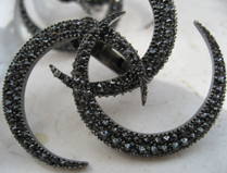 closeup of the VBH black diamond earrings